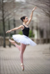Ballerina poses by the Wortham Center in Downtown Houston