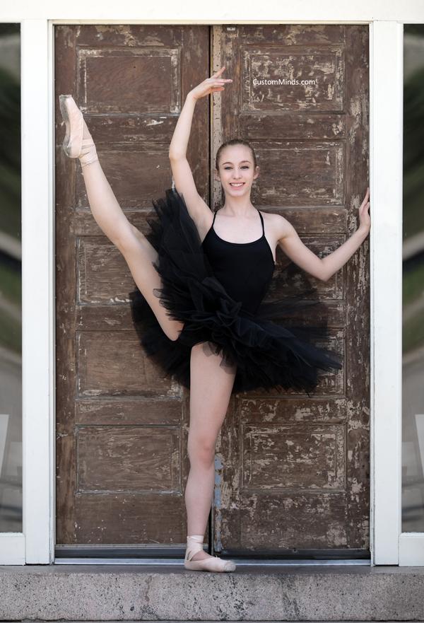 Ballerina poses by door