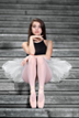 ballerina poses by the wortham center steps