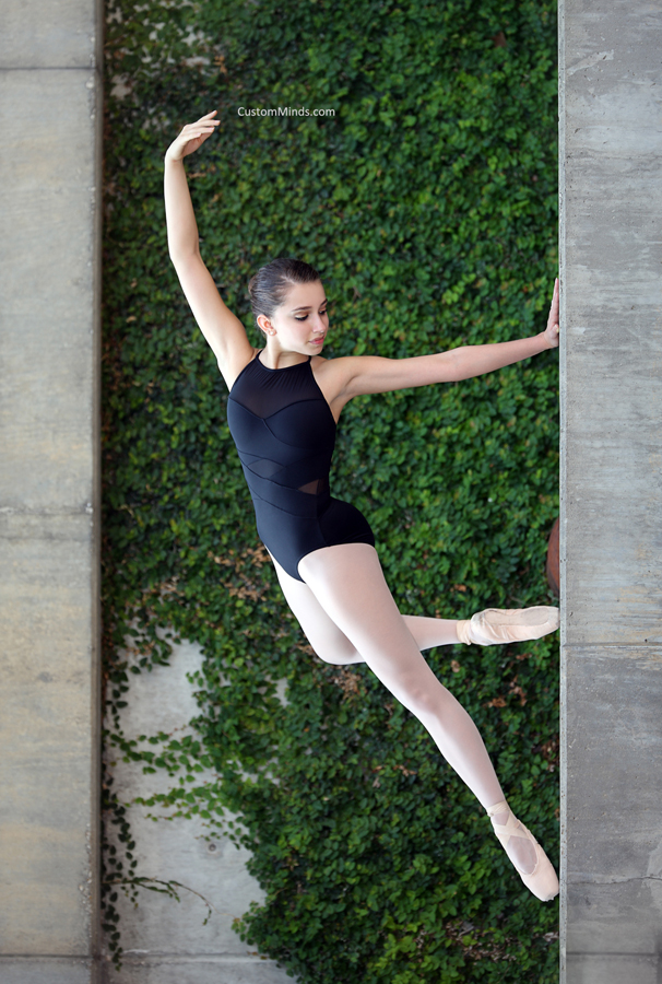 ballerina poses by green vines
