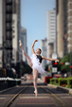 Ballerina poses by the metro rail in downtown Houston