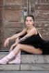 Ballerina poses by doors