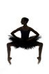 Ballerina poses in studio with a silhouette