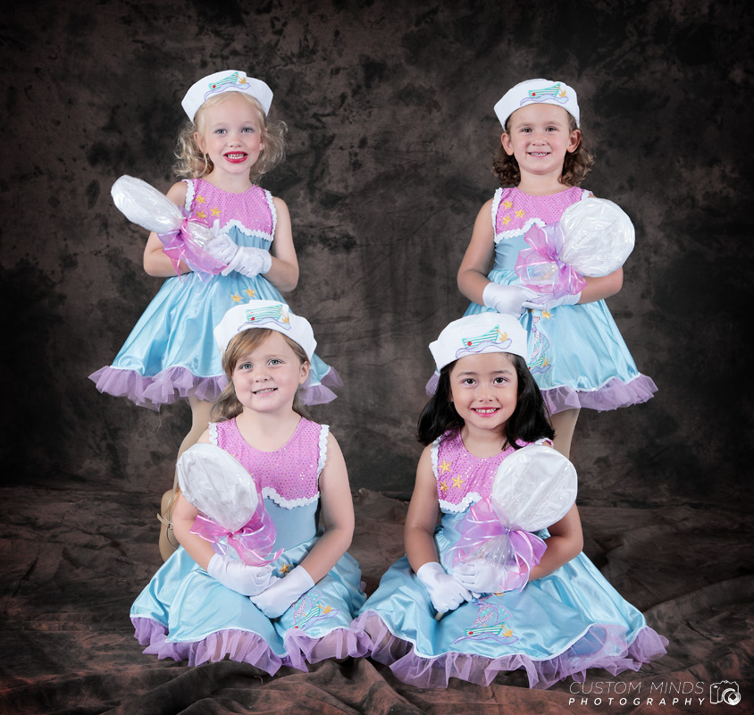 four children pose for a group picture
