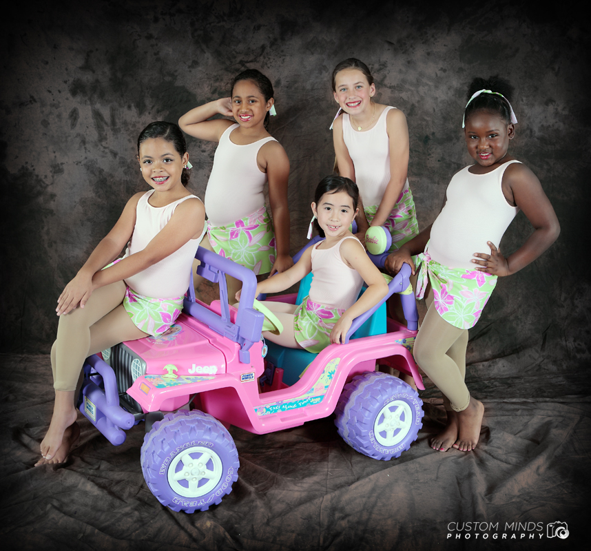 childrens dance group with jeep power wheel.
