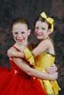 two girls hug at dance studio
