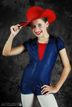 girl tips hat at dance studio