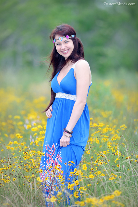blue dress in a field of yellow flowers