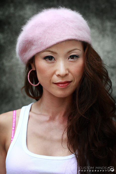 headshot of model with concrete background