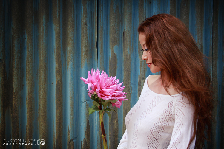 artist with pink flower in tokyo