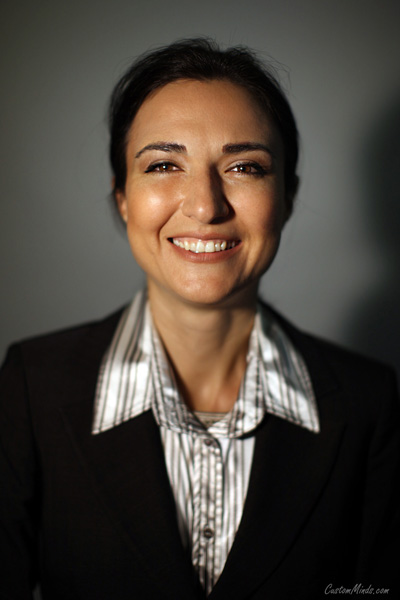employee headshot with woman in suit
