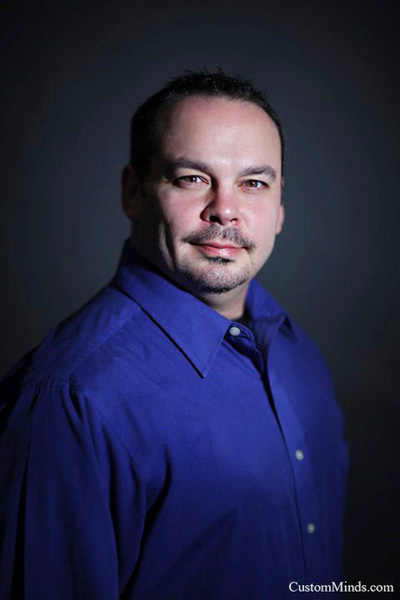 corporate headshot with man in suit
