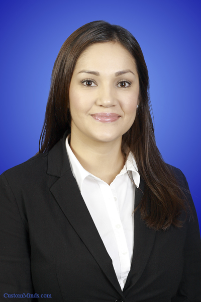 woman in suit with blue background
