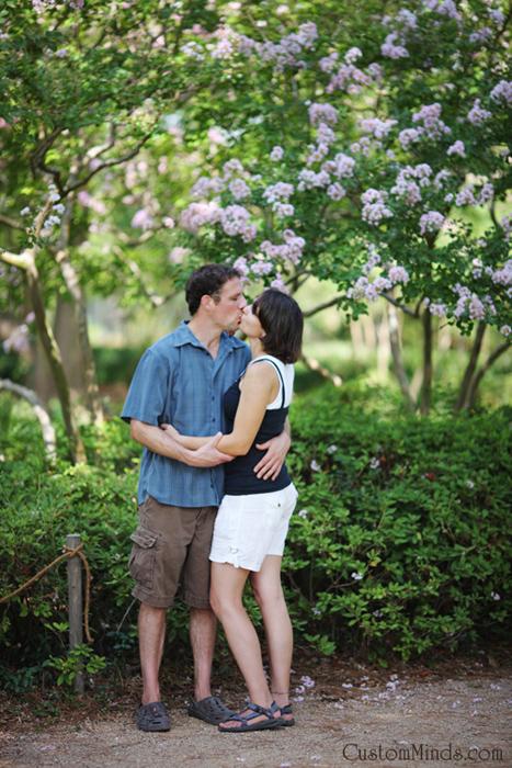 couple kssing at the japanese gardens in hermann park