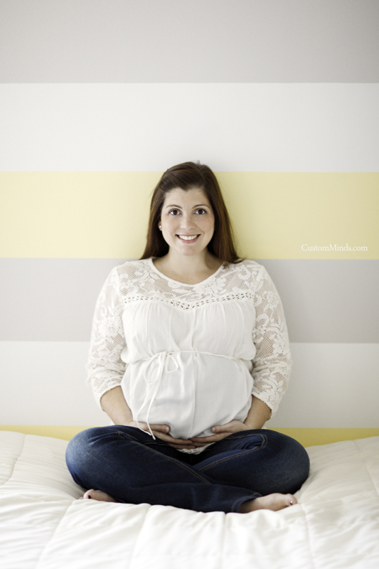maternity photo of mom in babys room