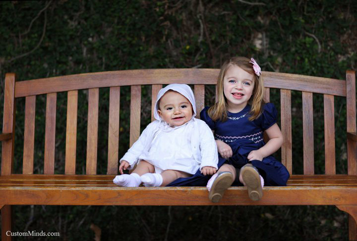 children sit on park bench
