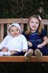 children sit on park bench