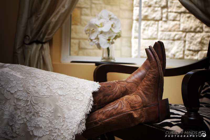 Bride relaxing in boots at Briscoe Manor in Richmond Texas