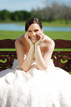 Bride in chair by lake in Richmond Texas