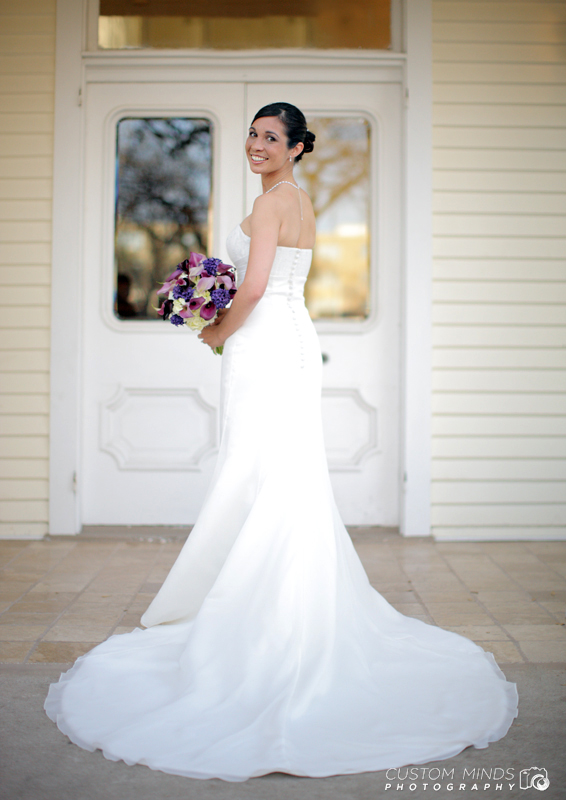 Bride posing with her bouquet at the Allan House in Austin