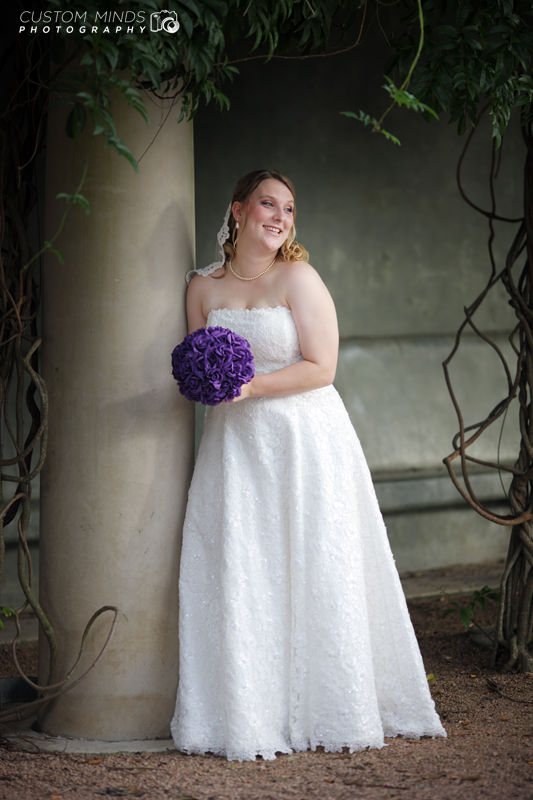 Bride smiles during photo shoot at Hermann Park in Houston Texas.