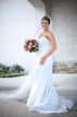 Smiling bride standing by pillars at a church in the Woodlands Texas