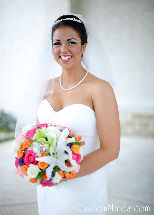Bride smiling with her bouquet in the Woodlands, Texas