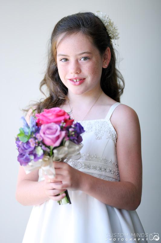 flower girl smiles as her portrait is taken