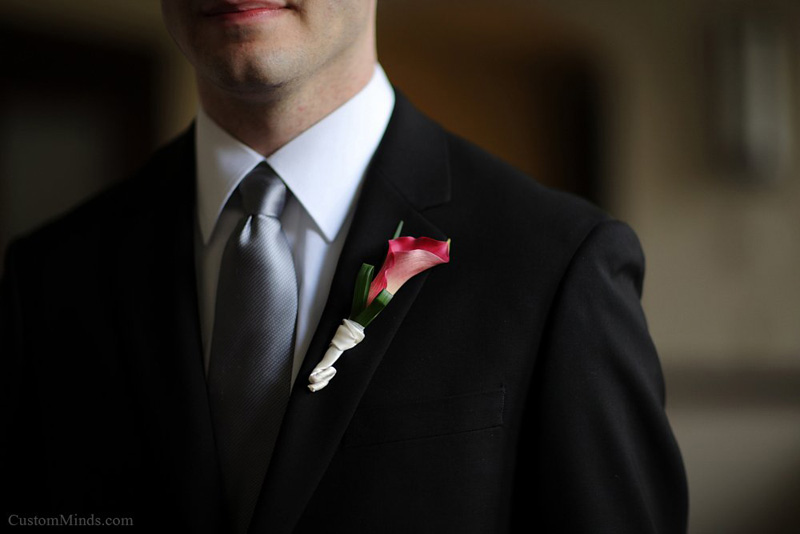 Boutonniere pinned on the Groom