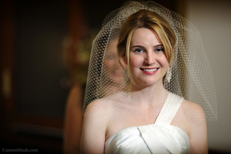 Bride smiling as she prepares to walk down the aisle