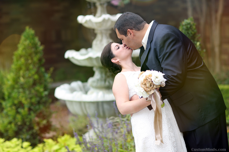 kissing in front of St Laurence Catholic Church in Sugarland Texas