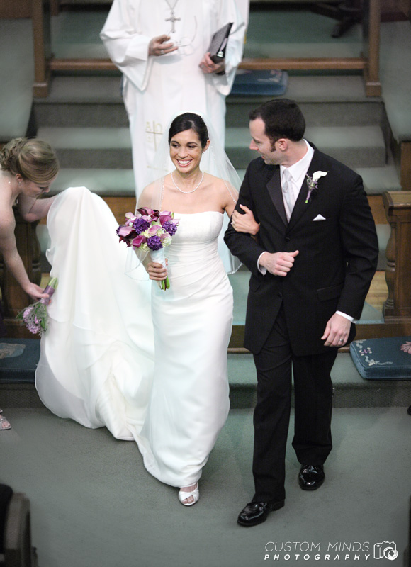 Bride and Groom leaving the altar at a Church near the Museum District in Houston Texas