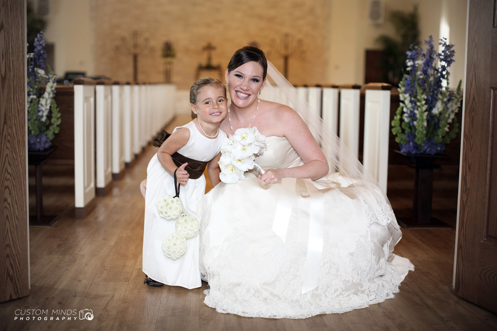 Bride and flower girl with big smiles