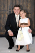 Groom and flower girl with big smiles