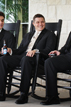 Groom and Groomsmen relaxing on rocking chairs drinking beers