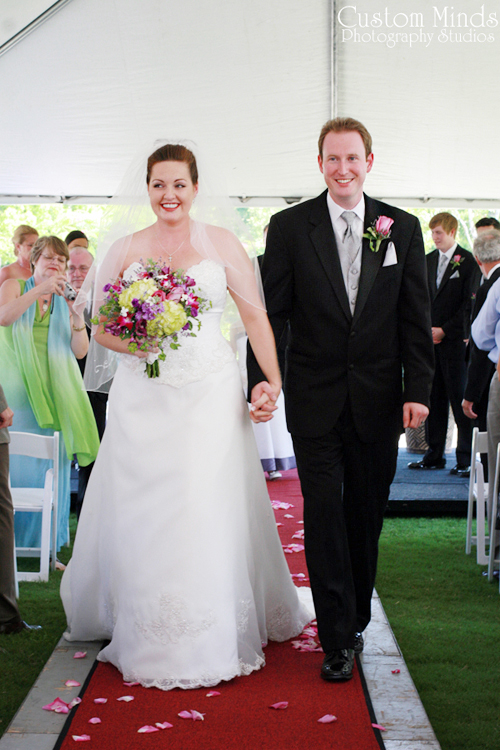 Bride and Groom in Navasota walking down the aisle