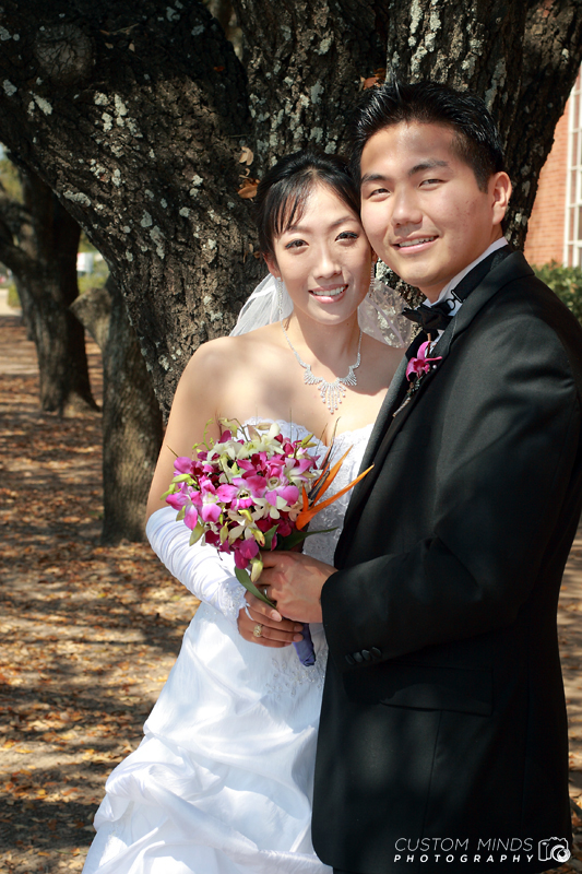 Bride and Groom posing with bouquet in Bryan College Station Texas