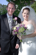 Bride and Groom posing with bouquet in Navasota Texas