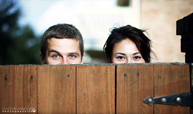 Playing peek-a-boo at an engagement session in Katy Texas