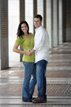 Standing in the hallway during an engagement session at Rice University
