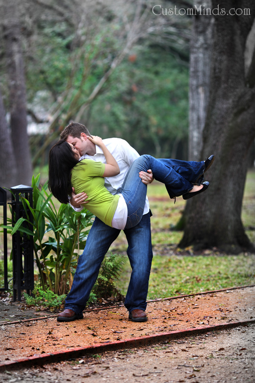 An engagement kiss on the pathway to Rice University