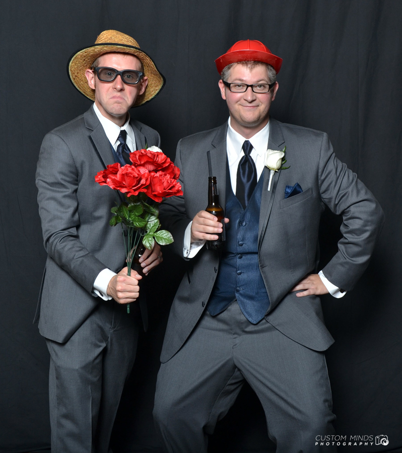 Groomsmen have a fun time in the wedding photo booth