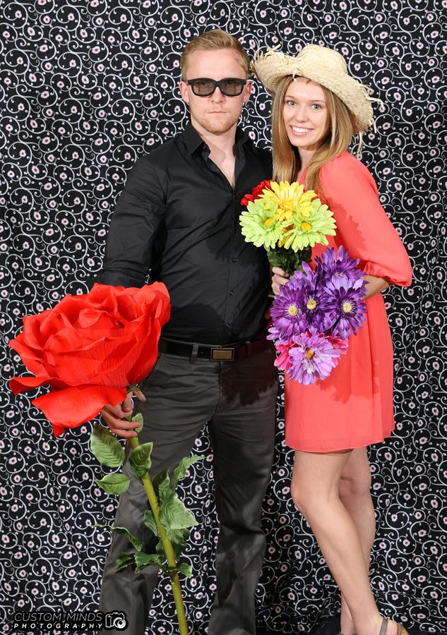 Couple having fun at our San Antonio Wedding photo booth