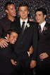 Groom and groomsmen joking around in out Katy Texas photo booth