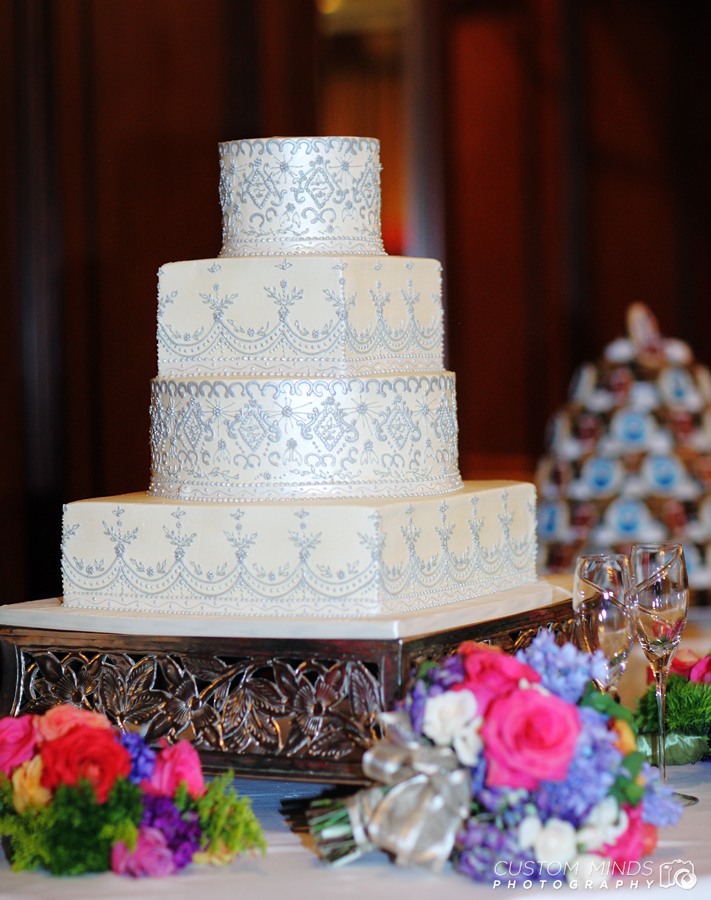 Wedding cake with flowers at the Houstonian ballroom in Houston Texas