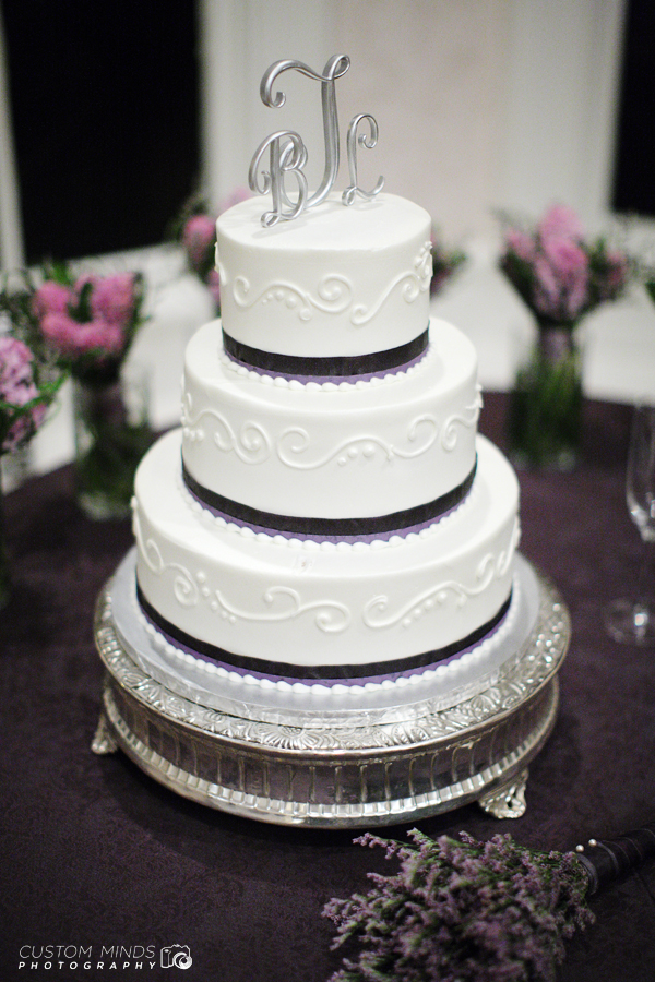 Wedding Cake with surrounding flowers at a reception in Austin Texas