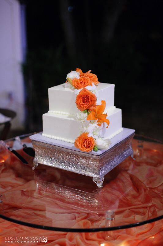 Wedding Cake with flowers at a reception in Friendswood Texas