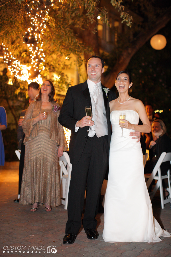 Bride and Groom react to a toast given in their honor