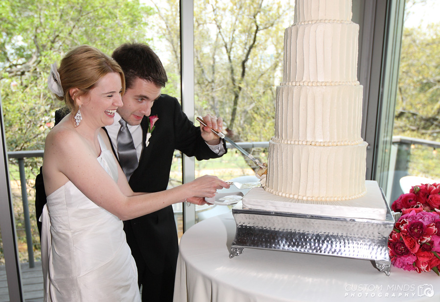 bride and Groom cut their Wedding cake at The Grove by Discovery Green Park in Houston Texas