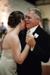 Father of the Bride laughing during his first dance with the Bride in Richmond Texas